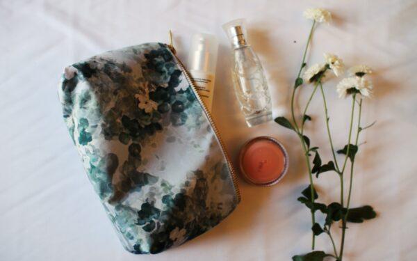 Green makeup bag with white jasmine flower print