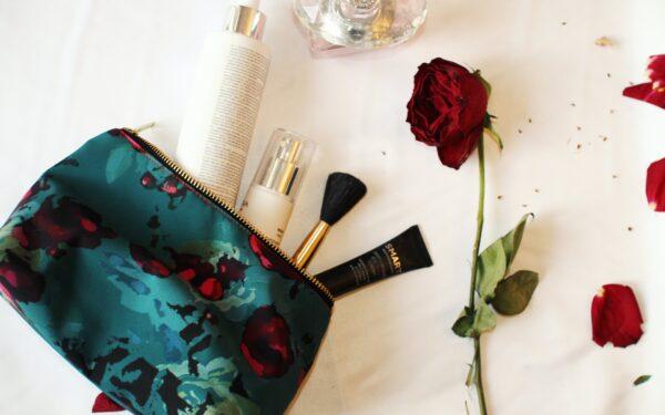 Waterproof green makeup bag with red rose flower print