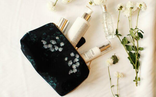 Waterproof black makeup bag with white flower print