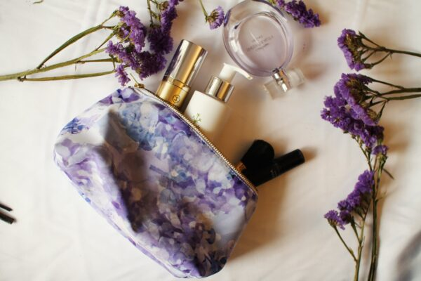 Waterproof blue and purple makeup bag with lilac flower print