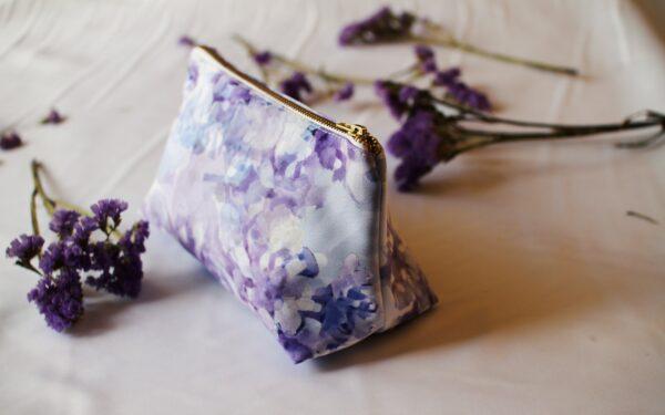 Waterproof purple makeup bag with lilac flower print